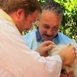 "11 Katie Oxford Blessing of the Animals at Bellaire United Methodist March 2015 Pastor Jim Flagg, ""Covert Commander Chaos"" a westie, and owner, Eric"