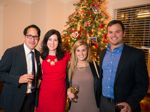 2229 67 Frank Guerra, from left, Jamie Joiner, Olivia Froncillo and Ryan Wirth at the Joiner holiday party December 2013