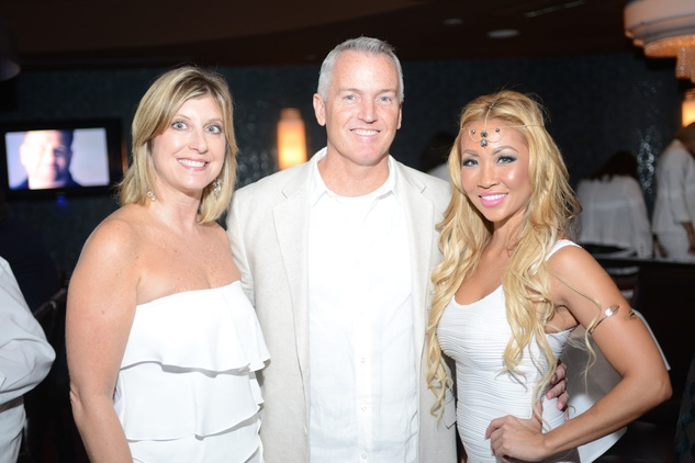 66 Kim Singer, from left, Mark Williams and Melanie Vo-Pham at the White Hot Summer Night Party at Eddie V's August 2014