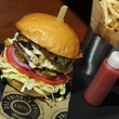 Del Frisco's Grille Hatch Green Chile Double Cheeseburger with Jalapeño Jack, Lettuce, Tomato, Frites, Pickle - $14