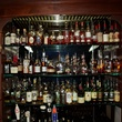 Downing Street Pub & Cigar Bar bar with wall of whiskey