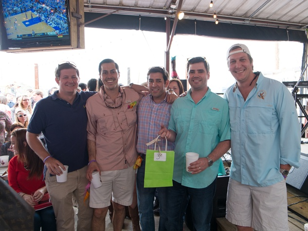 Travis Bourland, from left, Max Monzon, Michael Kruger, Ryan Mendez and Joel Gittemeier at the Casa de Esperanzas Young Professional Chili Cook-off February 2014