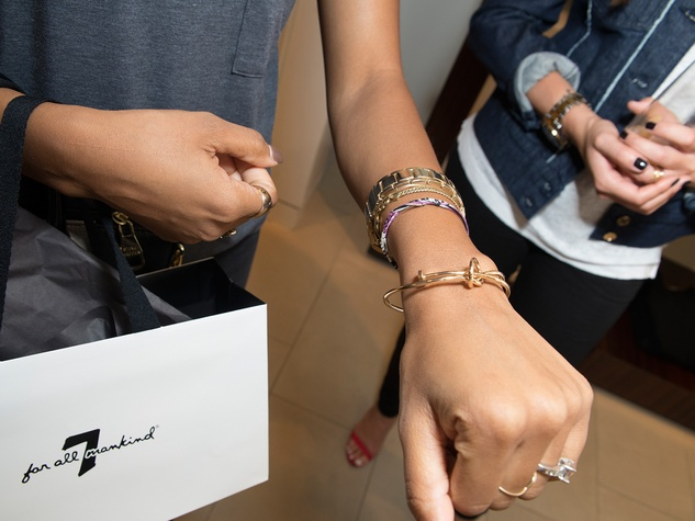 18 Trying on jewelry at the 7fam x All The Wire Launch Party at 7 For All Mankind October 2014