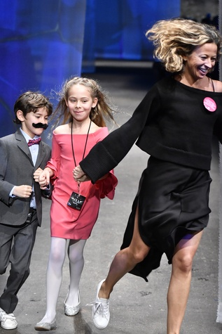 Milly designer Michelle Smith and children at end of fall 2017 runway show