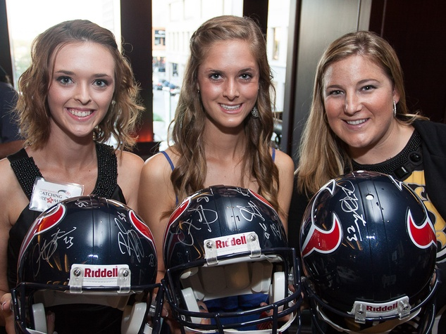 Owen Daniels, celebrity dinner, Houston Texas, September 2012, autographed helmets for auction