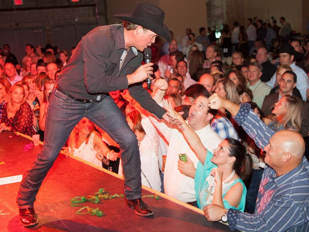 Clay Walker and  party-goers at Two Steppin' with TIRR Concert with Jerry Jeff Walker and Clay Walker October 2014