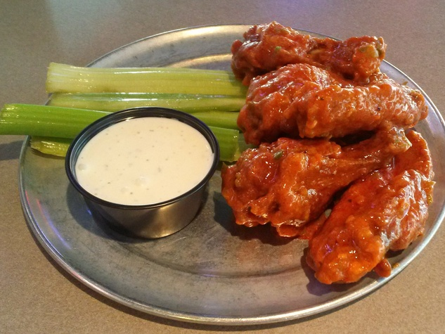Pluckers Wing Bar celery with dip and chicken wings
