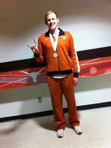 UT Longhorn swimmer Matt Korman giving Hook Em Horns