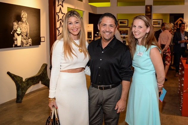 52 Patti Murphy, from left, Bruce Padilla and Rachael Wright at the HeartGift photo exhibition May 2014
