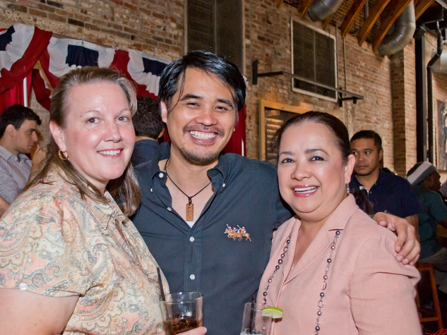 19 LeeAnne Nash, from left, Anthony Guevara and Tess Tuazon at the Young Professionals Grand Prix kick-off party June 2014