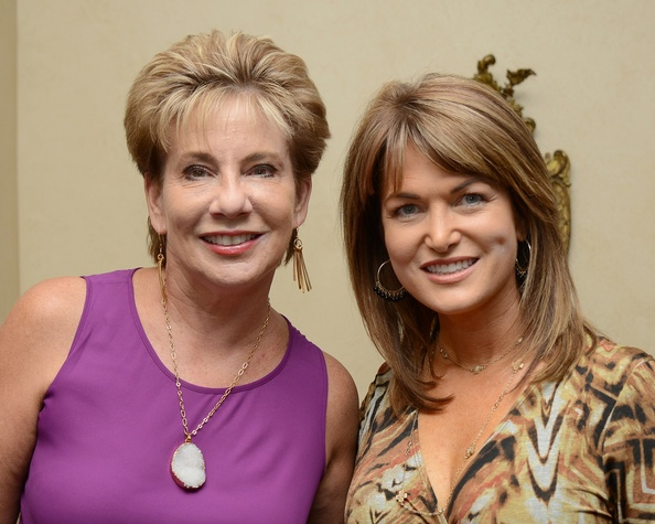 10 Dr. ZoAnn Dreyer, left, and Melissa Wilson at the Celebration of Champions kick-off September 2014