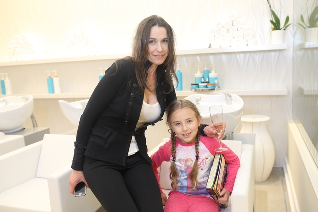 218 Oksana Duke, left, and Evelina Duke at the Uptown Blow Dry grand opening in Vintage Park March 2015
