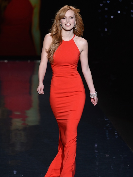 Bella Thorne, wearing Badgley Mischka, walks the runway at Go Red For Women - The Heart Truth Red Dress Collection 2014 Show February 2014
