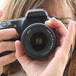 woman taking a photograph with a camera camera lens