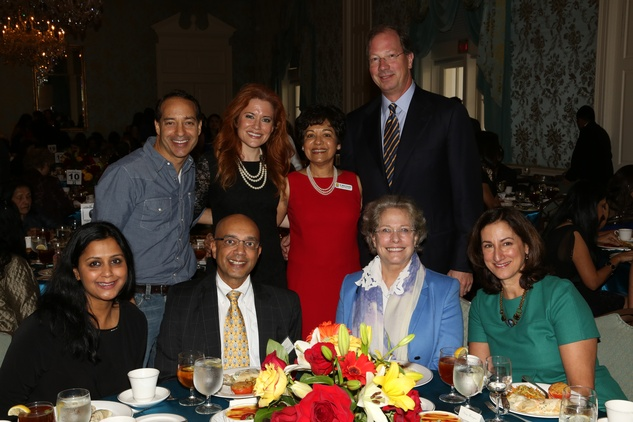 9. Vinita Gupta, from left, Vijay Goradia, Lillie Robertson and Nancy Thorington. Standing, from left, Lynt Graft, Ingrid Vanderveldt, Marie Goradia and Steve Thorington at the Chloe Dao luncheon for Pratham December 2014