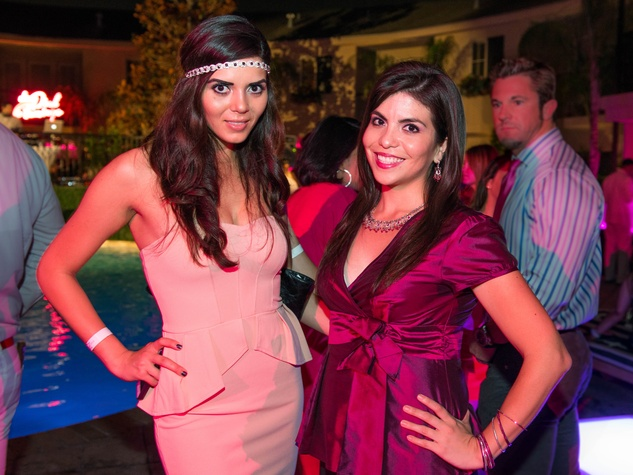 25 Iris Alvarez, left, and Ary Ruiz at the Pink Party at Hotel ZaZa July 2014
