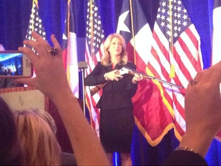 Wendy Davis holding rifle