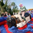 Jax Oncale, age 7, rides a mechanical bull at Howl-O-Ween Fest held Saturday in Bridgeland