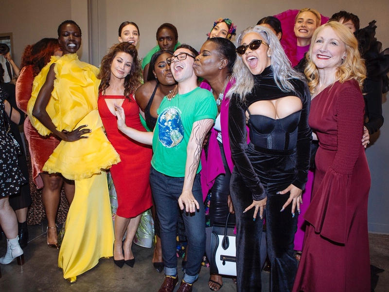 Christian Siriano, center, surrounded by stars including Leslie Jones after runway show at New York Fashion Week