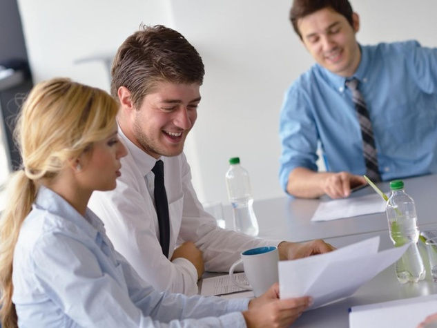 young business professionals in office at conference table