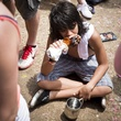 Person eating turkey leg at Free Press Summer Festival June 2013