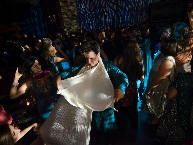 Baruch Garcia dances with his friends at Bollywood Ball