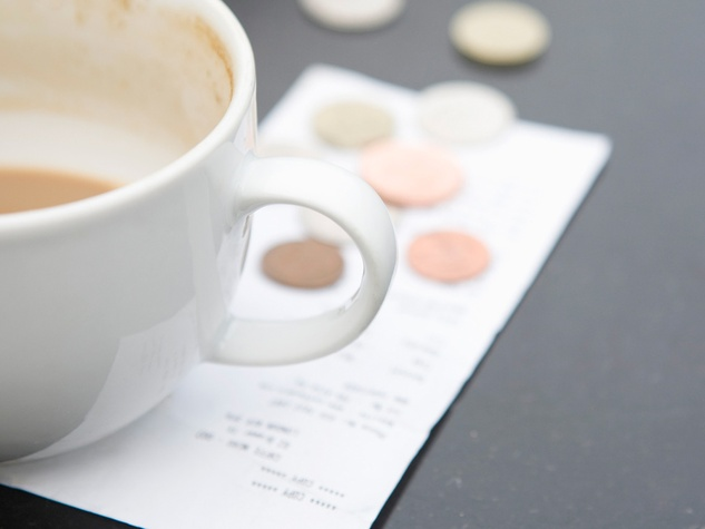 restaurant tip coins empty cup of coffee