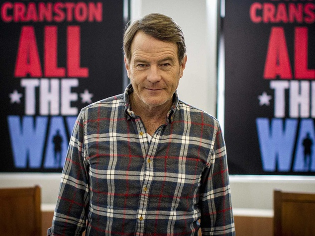 Bryan Cranston in front of All the Way posters