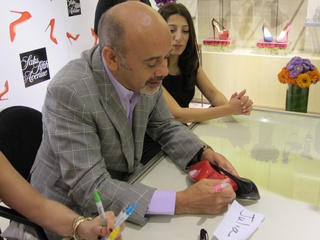 Louboutin, signing shoes, October 2012