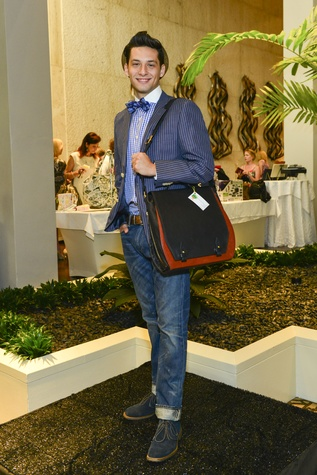79 Neal Hamil model in Festari suit with men's bag for bid at Heroes and Handbags May 2014