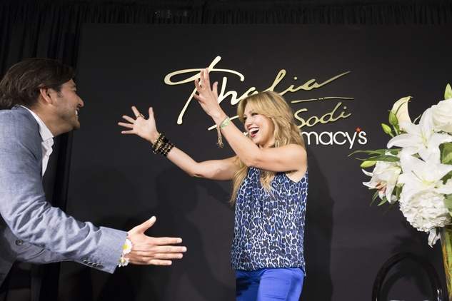 Thalia greets a fan at Macy's Memorial City store