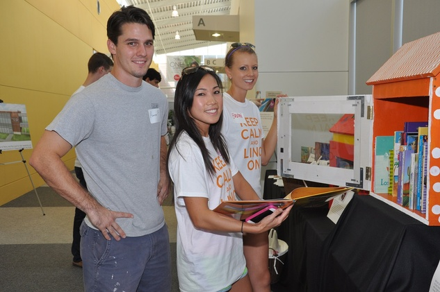5 Aaron Pelletier, from left, Diana Dao and Britni Keth at young professionals build Tiny Libraries September 2014