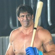 Jose Canseco in boxing gloves with baseball bat