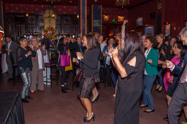20 The crowd dancing at the Beat the Holiday Blues event December 2014