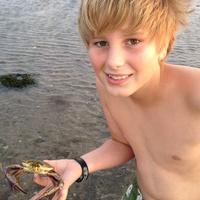 Boy with crab on beach
