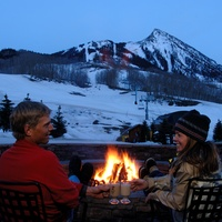 4 Promoted Article No. 1 Elevation Hotel & Spa January 2014 couple outside with fire and mountain