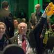 Carol Linn, from left, Terry Bradshaw waving the Terrible Towel and Mike Linn at the Touchdown for Teachers dinner November 2014