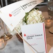 8 Table setting with program at the Leukemia & Lymphoma Society Man and Woman of the Year Gala June 2014