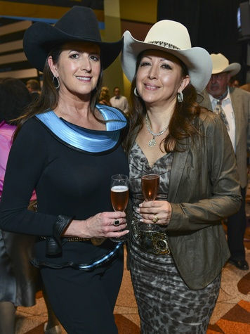 5 Stephanie Baird, left, and Gigi Wark at the RodeoHouston Wine Auction Dinner March 2014