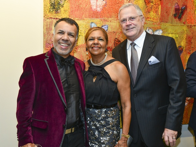 9 Tony Bravo, from left, Yvonne Cormier and Richard Werner at the Holiday Schmooze December 2013