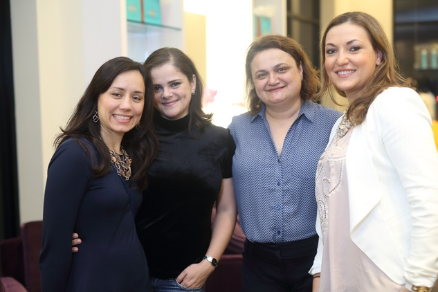 257 Ella Teodorescu, from left, Gabi Nicola, Ioana Lazarescu and Delia Prada at the Uptown Blow Dry grand opening in Vintage Park March 2015