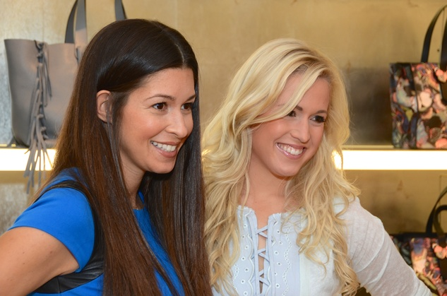 Caroline Walter, left, and Ericka Graham at the Una Notte in Italia lunch at Valentino September 2014