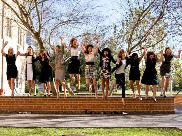Rice University Jones Graduate School of Business girls jumping off stairs