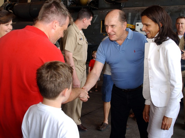 "Duvall with future wife Luciana Pedraza (right) shaking hands with a member of the ""The Black Stallions"" of Helicopter Combat Support Squadron Four at the Taormina Film Fest in Sicily in June 2003"