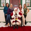 11 Mary Prator, from left, Mary Kathryn Cooper, Santa, Janet McCloskey and Tanya Ellenberg at the M.D. Anderson Breakfast with Santa December 2014