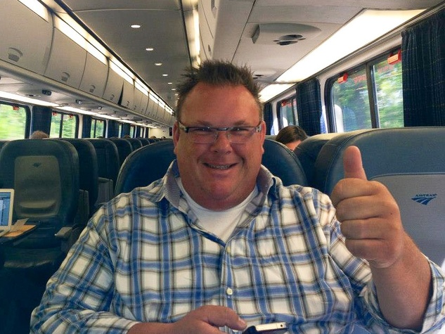 Chef Chris Shepherd thumb's up on train from D.C. to NYC May 2013 James Beard Awards