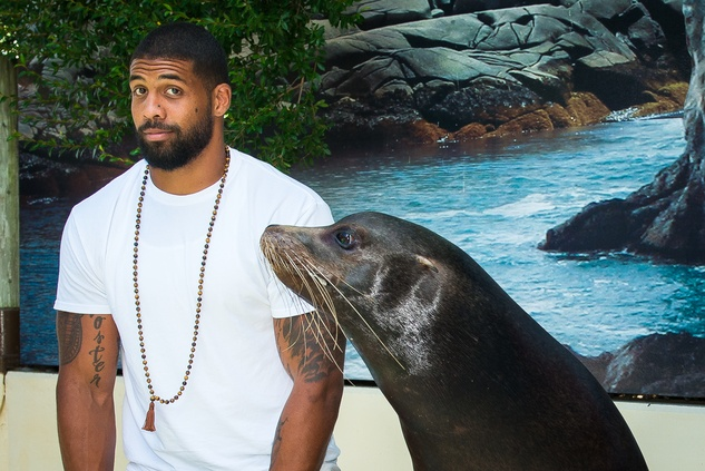 Houston Texan Arian Foster at Houston Zoo with seal
