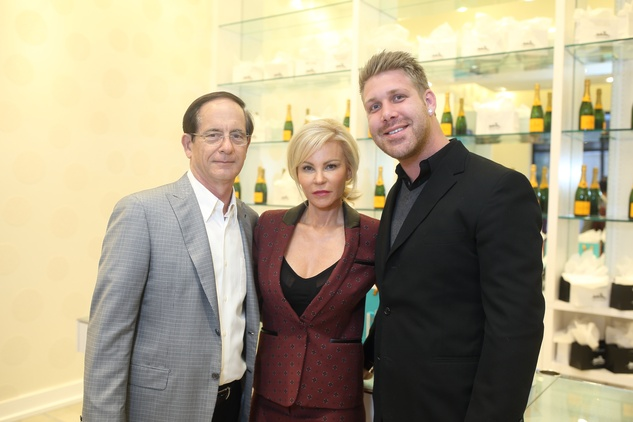 193 Robert and Shelly Rudin, left, and Michael Morton at the Uptown Blow Dry grand opening in Vintage Park March 2015