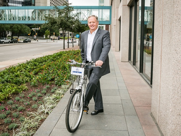 Lockton Companies CEO Bruce Sammis with Zagster bicycle