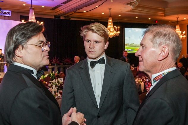 14 Michael Collins, from left, Stewart Morris III and Stewart Morris Jr. at the  Houston Baptist University Lou Holtz dinner November 2014